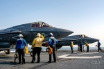 U.S. 5th FLEET AREA OF OPERATIONS (Sept. 27, 2018) Sailors assigned to the USS Essex (LHD 2) prepare F-35B Lightning II aircraft, assigned to Marine Fighter Attack Squadron 211, 13th Marine Expeditionary Unit, for launch.